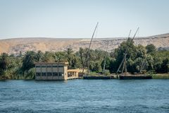 Buildings and homes on the banks of the Nile river. Egypt. Africa aswan country cityscape nilo village water architecture boat circumscription construction royalty free stock photography