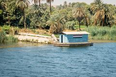Buildings and homes on the banks of the Nile river. Egypt. Africa aswan country cityscape nilo village water architecture boat circumscription construction royalty free stock photo