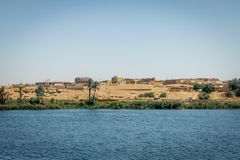 Buildings and homes on the banks of the Nile river. Egypt. Africa aswan country cityscape nilo village water architecture boat circumscription construction stock photo