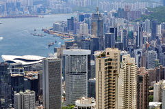 Buildings in Hongkong city and Victoria harbor Stock Photo