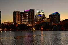 Buildings, Hotels and Church domes in front Lake Eola Park on beatiful sunset background. royalty free stock photos