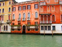Buildings in Italy. Old colorful buildings in Venice, Italy with superb architecture on Grand Canal prepared for Venetian masks carnival Royalty Free Stock Photography