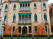 Buildings in Italy. Old colorful buildings in Venice, Italy with superb architecture on Grand Canal prepared for Venetian masks carnival Stock Photo