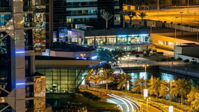 Buildings of Jumeirah Lakes Towers with traffic on the road night timelapse. The JLT is a large development which consists of 79 towers being constructed along stock video