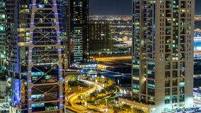 Buildings of Jumeirah Lakes Towers with traffic on the road night timelapse. stock video footage