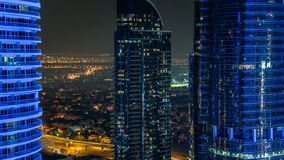Buildings of Jumeirah Lakes Towers with traffic on the road night timelapse. The JLT is a large development which consists of 79 towers being constructed along stock footage