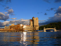 Buildings beside lake Stock Photography