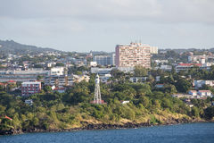 Buildings and Lighthouse on Coast of Martinique Royalty Free Stock Image