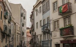 Buildings in Lisbon, Portugal. An image of the city of Lisbon. Townhouses with balconies on both sides of the street Royalty Free Stock Photos