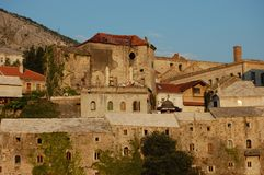 Buildings lit by the setting sun at Mostar Royalty Free Stock Photography