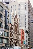 Buildings located along West 37th Street at Broadway, Manhattan, including the iconic Roman Catholic Church of the Holy Innocents Stock Photo
