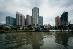 Buildings in Mandaluyong and the Pasig River, in Makati, Metro M Stock Photo