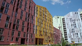 Buildings with many-coloured facades. And blue sky with clouds stock footage