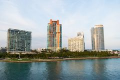 Buildings of miami, usa on sea shore. Building houses on cloudy sky.  Royalty Free Stock Photography