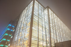 Buildings in Misty nights. Glowing in the misty night city buildings Stock Images