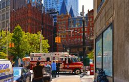 buildings, modern and old architecture, busy traffic, firefighters car and people on the streets in downtown manhattan stock image