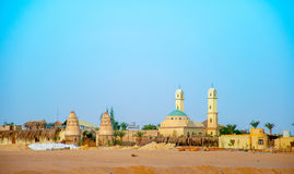 The buildings and a mosque in the Arabian desert Royalty Free Stock Photography