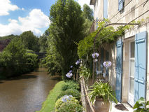 Buildings next to river in St Jean de Cole, Dordogne, France Royalty Free Stock Image