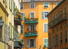Buildings in Nice, France. Building details including shutters and balconies of buildings in Nice, France Stock Image