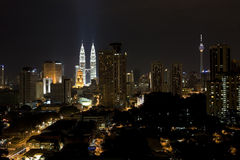 Buildings at Night. Section of the Business District of Kuala Lumpur showing the famous twin towers Royalty Free Stock Photography