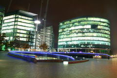 Buildings at night. A colourful photo of London at night with the river Thames near tower bridge stock images