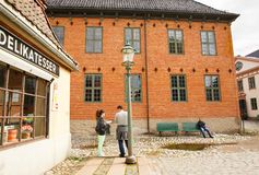 Buildings at Norsk Folkenmuseum. Oslo, Norway-August 13, 2014 - Traditional old houses and people at Norsk Folkemuseum royalty free stock image