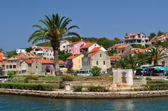 Buildings and palm tree in Vrboska. Island Hvar, C Stock Image