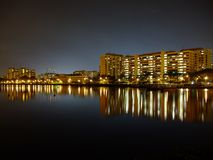 Buildings by Pandan reservoir under blue night sky Royalty Free Stock Photos