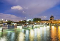 Buildings of Paris around Louvre complex with Seine river at nig. Ht, France Royalty Free Stock Photography