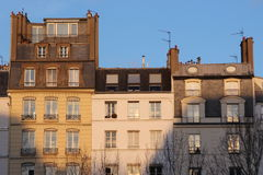 Buildings in Paris with sunset ligth Stock Images