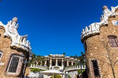Buildings In Park Guell, Barcelona,Catalonia,Spain. Gate Houses And Greek Theatre Square - Park Guell, Barcelona, Catalonia, Spain, Europe Stock Image