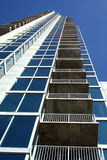 Buildings Patios. Looking straight up at  A modern tall buildings patios Stock Photography