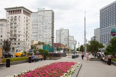 Buildings, people, flowerbed and benches 20.08.2018. MOSCOW, RUSSIA - AUGUST 20, 2018: Buildings, people, flower bed and benches in Novy Arbat street. This Stock Image