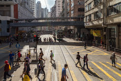 Buildings and people at pedestrian crossings in Hong Kong. View of buildings and people at pedestrian crossings on the Shau Kei Wan Road at the Quarry Bay on Stock Photography