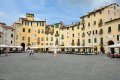 Buildings on Piazza dell`Anfiteatro square in Lucca city in Ital Royalty Free Stock Photos