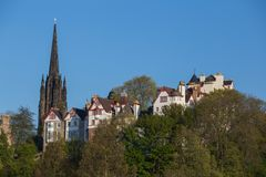 Buildings of Ramsay Gardens with the gothic spire of The Hub in E. Apartment buildings of Ramsay Gardens with the gothic spire of The Hub in Edinburgh, Scotland Stock Image