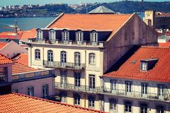Buildings with red roof in center of Lisbon, Portugal Royalty Free Stock Image