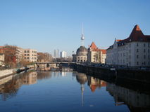 Buildings reflected in a river in Berlin, Germany. Historical buildings on the banks reflected in a tranquil river in Berlin, Germany with the Fernsehturm Stock Photo