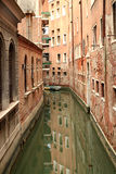 Buildings Reflected in a Side Canal, Venice Italy Royalty Free Stock Photography
