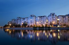 Buildings reflected in water. Bucharest night scene with Dambovita river Royalty Free Stock Image