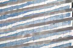 Buildings reflected in windows of modern office Royalty Free Stock Photography