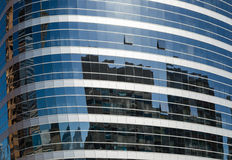 Buildings reflected in windows of office building Stock Photo