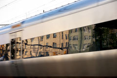 Buildings reflected in windows of train Stock Images