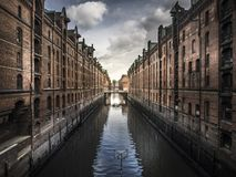 Buildings reflecting in canal stock photo