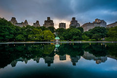 Buildings reflecting in the Conservatory Water in Central Park, Stock Image