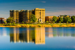 Buildings reflecting in Druid Lake, at Druid Hill Park in Baltim Royalty Free Stock Image