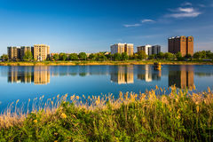 Buildings reflecting in Druid Lake, at Druid Hill Park in Baltim Stock Photography