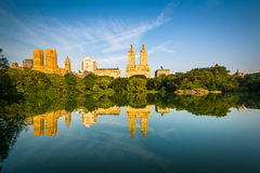 Buildings reflecting in The Lake, at Central Park, in Manhattan, Royalty Free Stock Images
