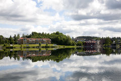 Buildings reflecting on a lake. Some buildings of a Norwegian village reflecting on a lake Royalty Free Stock Image