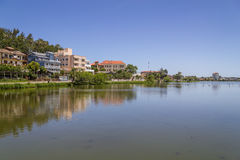 Buildings reflecting on the lake in Torres Stock Image